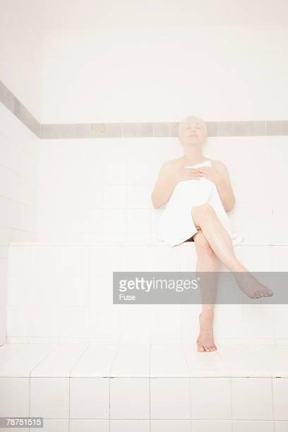 Woman Enjoying a Steam Room