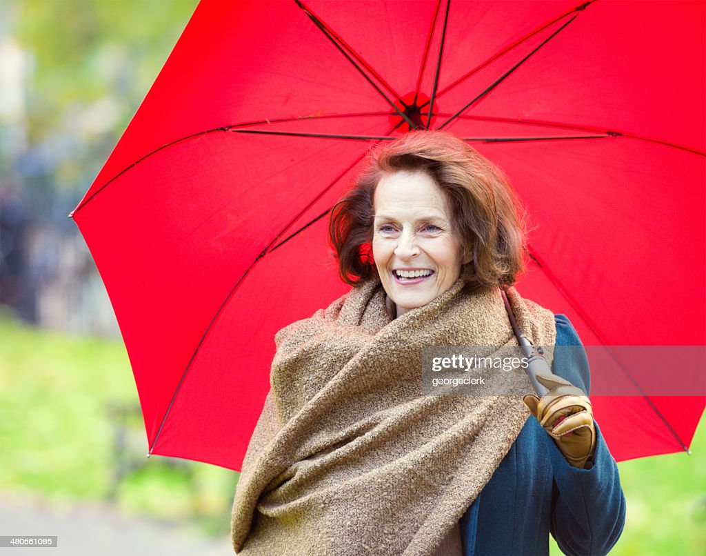 Woman enjoying an autumn walk : Stock Photo
