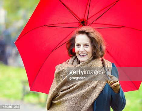 Woman enjoying an autumn walk : Stock Photo