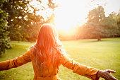 Woman enjoying autumn sun.