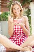 Woman Enjoying Bowl Of Breakfast Cereal