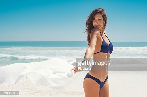 Woman enjoying breeze with scarf : Foto stock