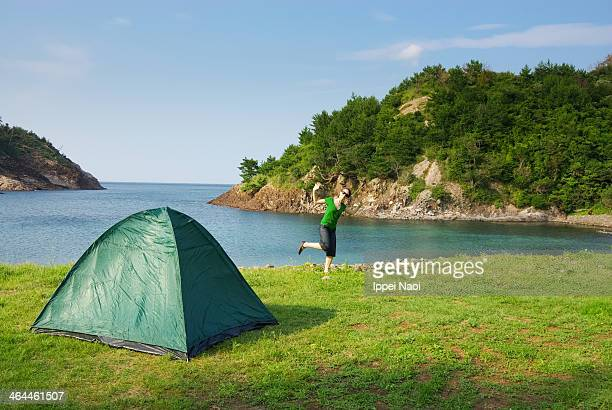 Woman enjoying camping by the sea