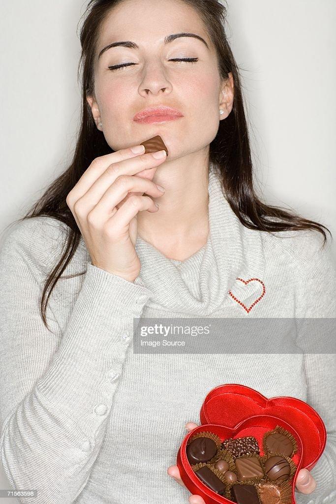 Woman enjoying chocolate : Stock Photo