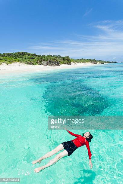 Woman enjoying clear tropical water.