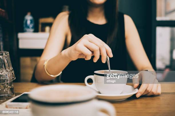 Woman enjoying coffee relaxingly in a cafe
