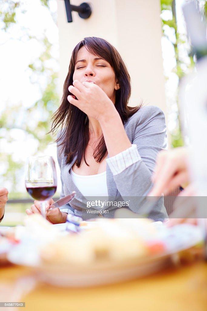 Woman enjoying dinner on loggia