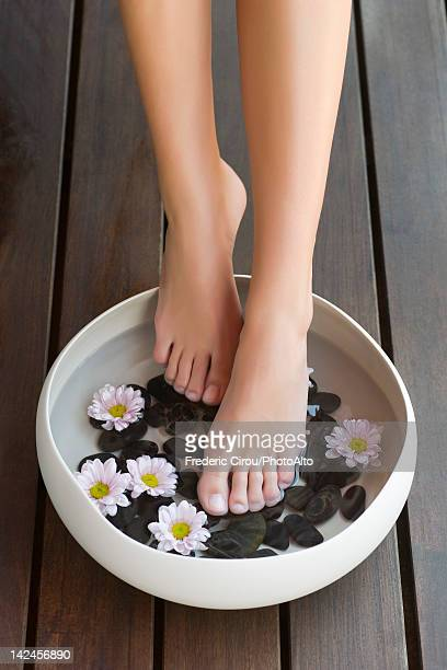 Woman enjoying foot bath, cropped