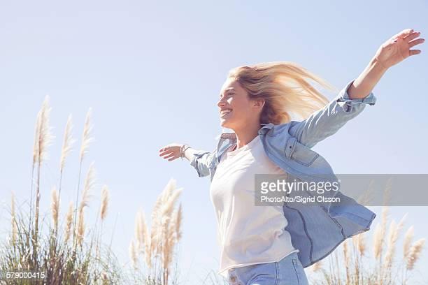 Woman enjoying fresh air outdoors