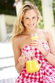 Woman Enjoying Glass Of Orange Juice