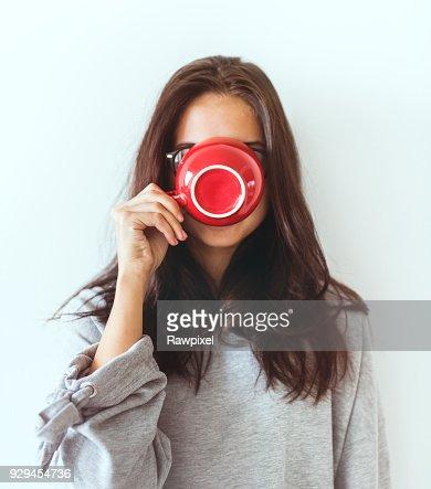 Woman enjoying her morning coffee : Stock Photo
