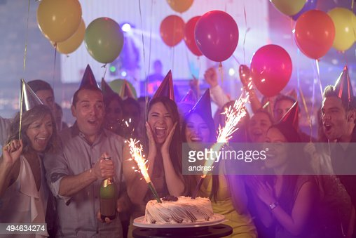 Woman enjoying her surprise birthday party