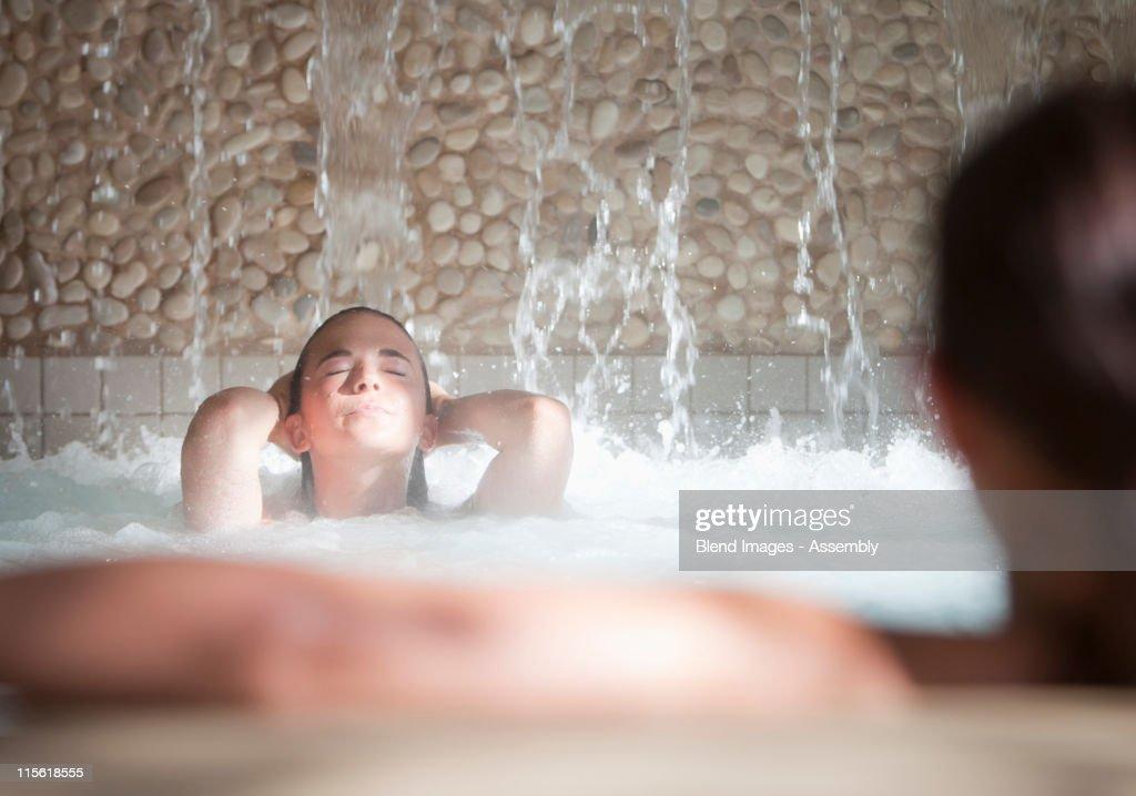 Woman enjoying hydrotherapy treatment : Stock Photo