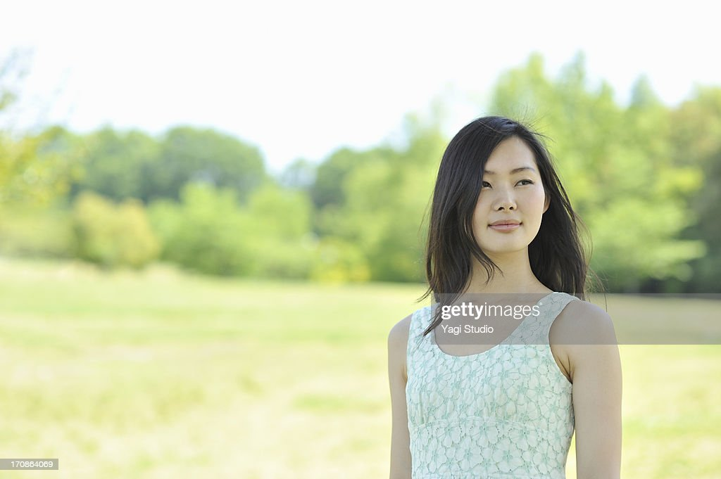 Woman enjoying in nature : Stock Photo