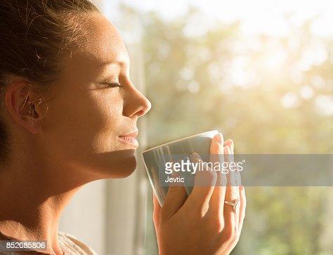 Woman enjoying morning coffee : Stock Photo