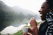 Woman enjoying morning coffee with nature
