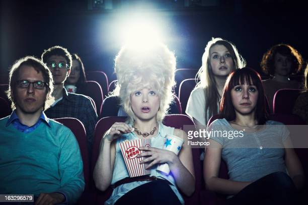 Woman enjoying movie at cinema