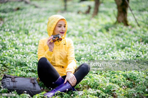 Woman enjoying nature in the forest during the springtime