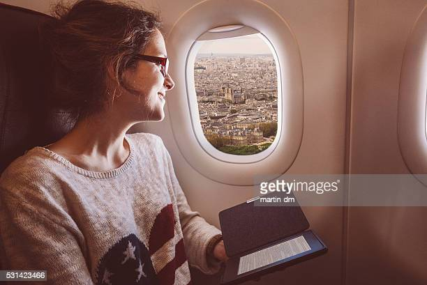 Woman enjoying Notre dame de Paris from the airplane window