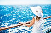 Woman enjoying on a cruise.