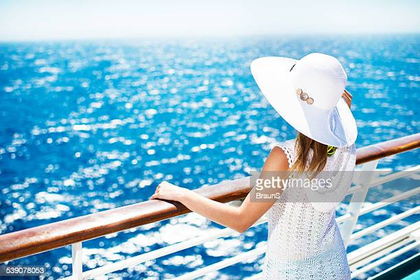 Woman enjoying on a cruise.