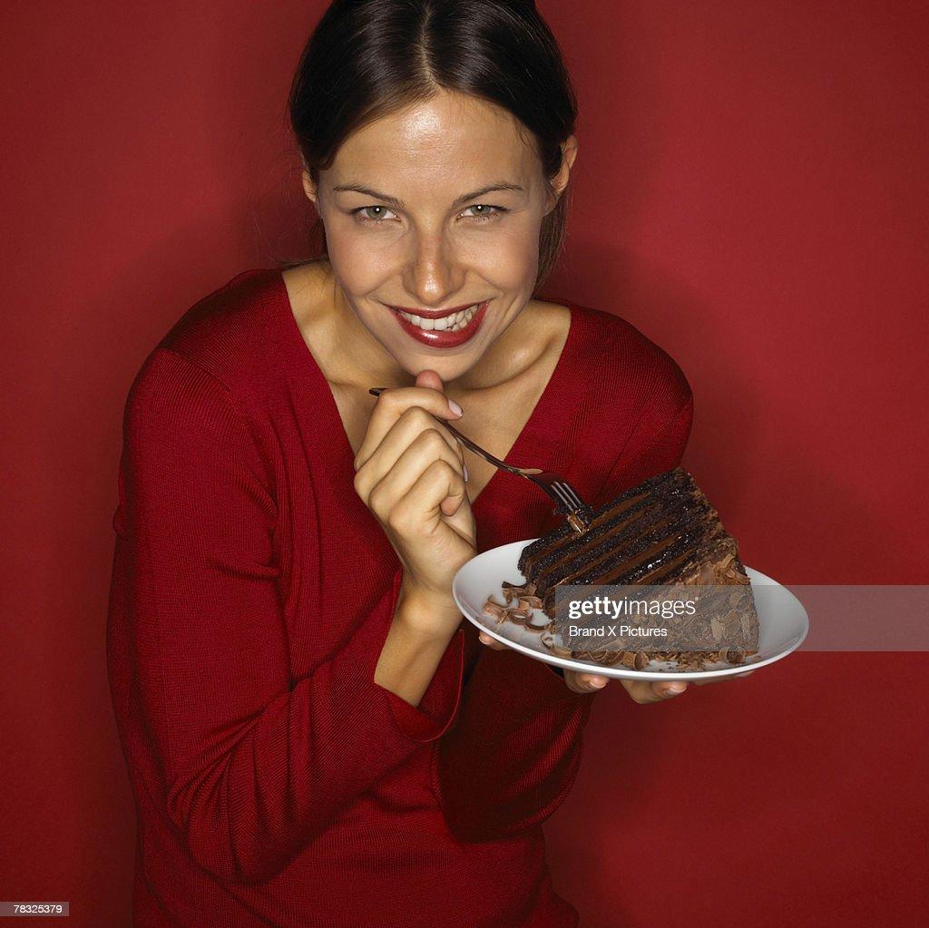 Woman enjoying piece of chocolate cake