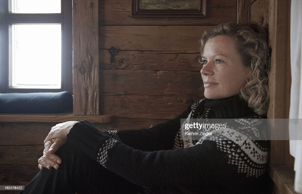 woman enjoying quiet moment in Austrian cabin : Stock Photo