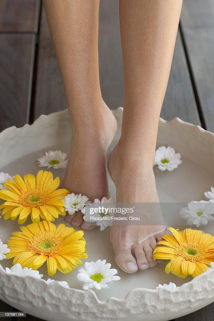 Woman enjoying relaxing foot bath