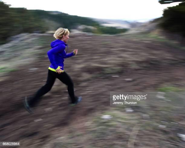 Woman Enjoying Running In The Mountains
