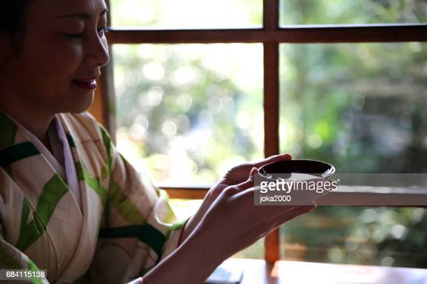 Woman enjoying Sake in cafe