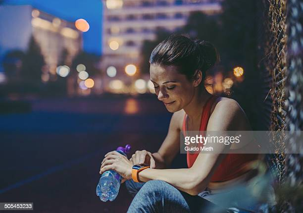 Woman enjoying smartwatch.