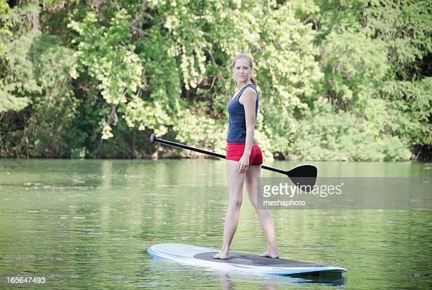 Woman Enjoying Stand-Up Paddling