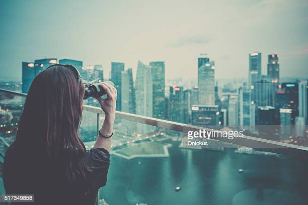Woman Enjoying the City View on Rooftop Deck