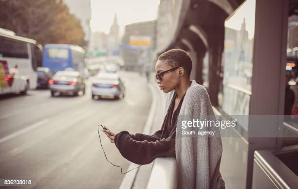Woman enjoying the music on the street