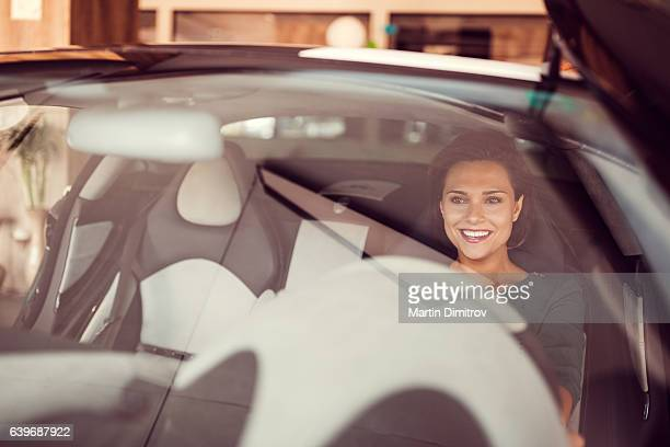 Woman enjoying the new car