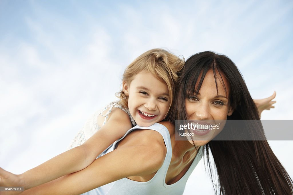 Woman enjoying the outdoors with daughter : Stock Photo