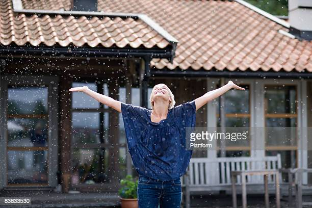 A woman enjoying the rain Sweden.