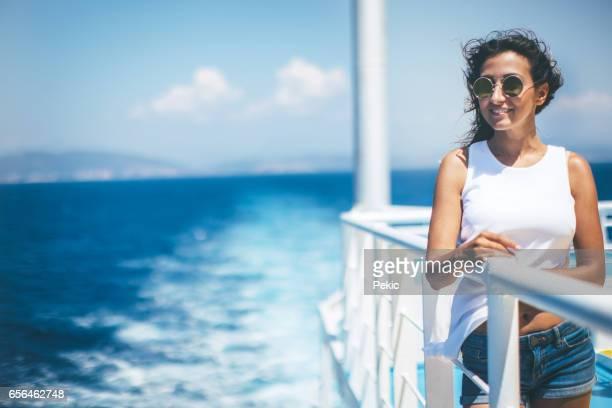 Woman enjoying the sea from cruise ship