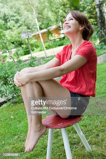 Woman enjoying the sun in the garden : Stock Photo