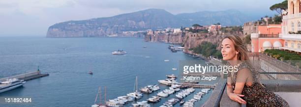 woman enjoying the view of Sorrento Bay, Italy