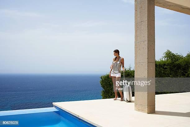 Woman Enjoying View From Patio