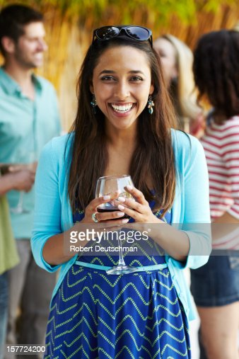 Woman enjoying wine with friends. : Stock Photo