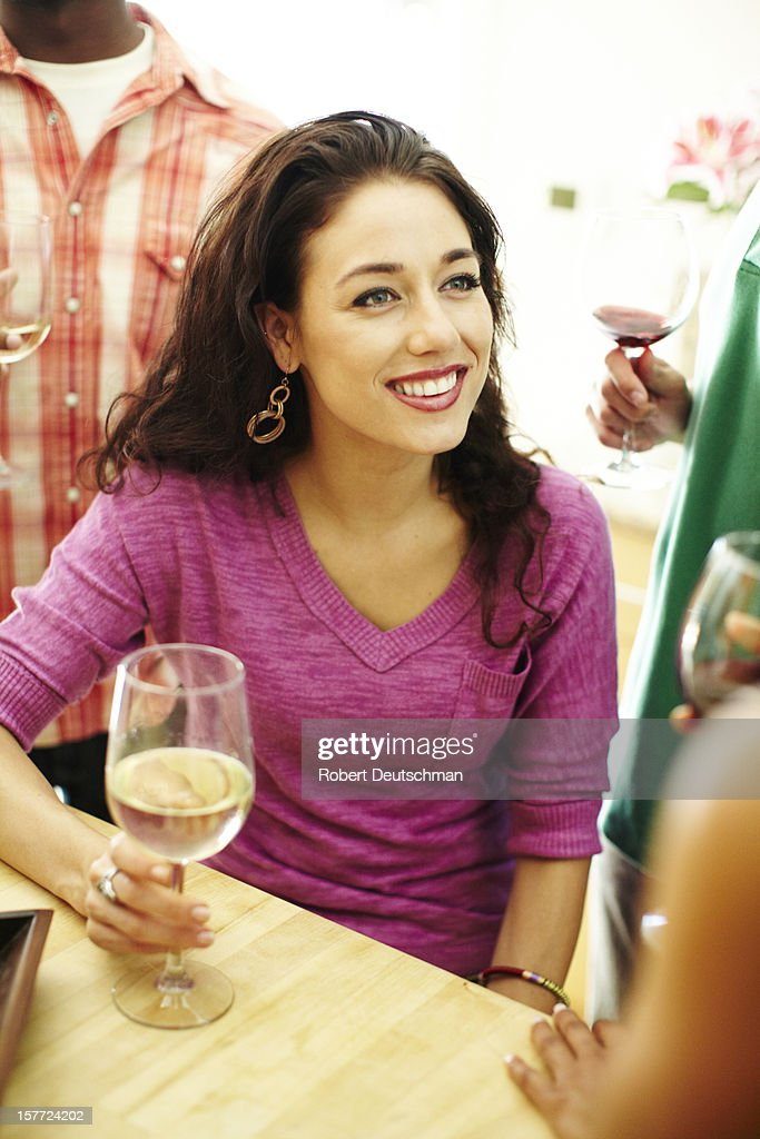 Woman enjoying wine with friends. : Stock Photo