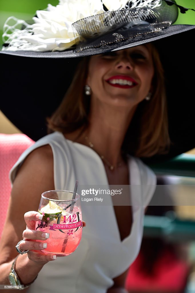 A woman enjoys an Oaks Lily drink prior to the 142nd running of the Kentucky Oaks at Churchill Downs on May 06, 2016 in Louisville, Kentucky.