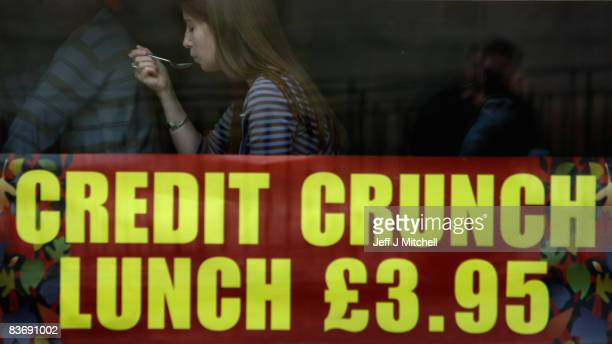 A woman enjoys his credit crunch lunch at a pub in Edinburgh on November 14 2008 in Edinburgh Scotland With a high likelihood of the Scottish economy...