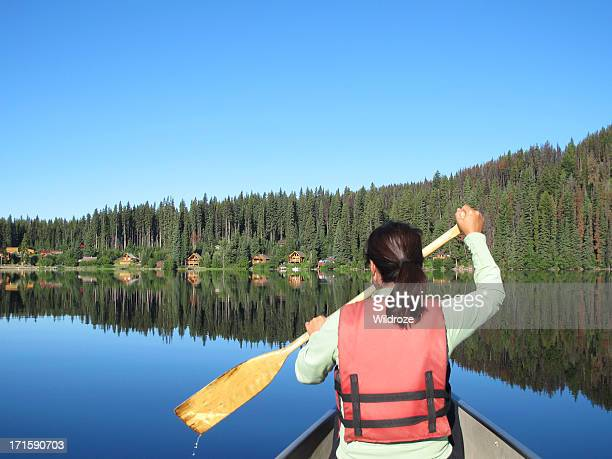 Woman enjoys nature while canoeing