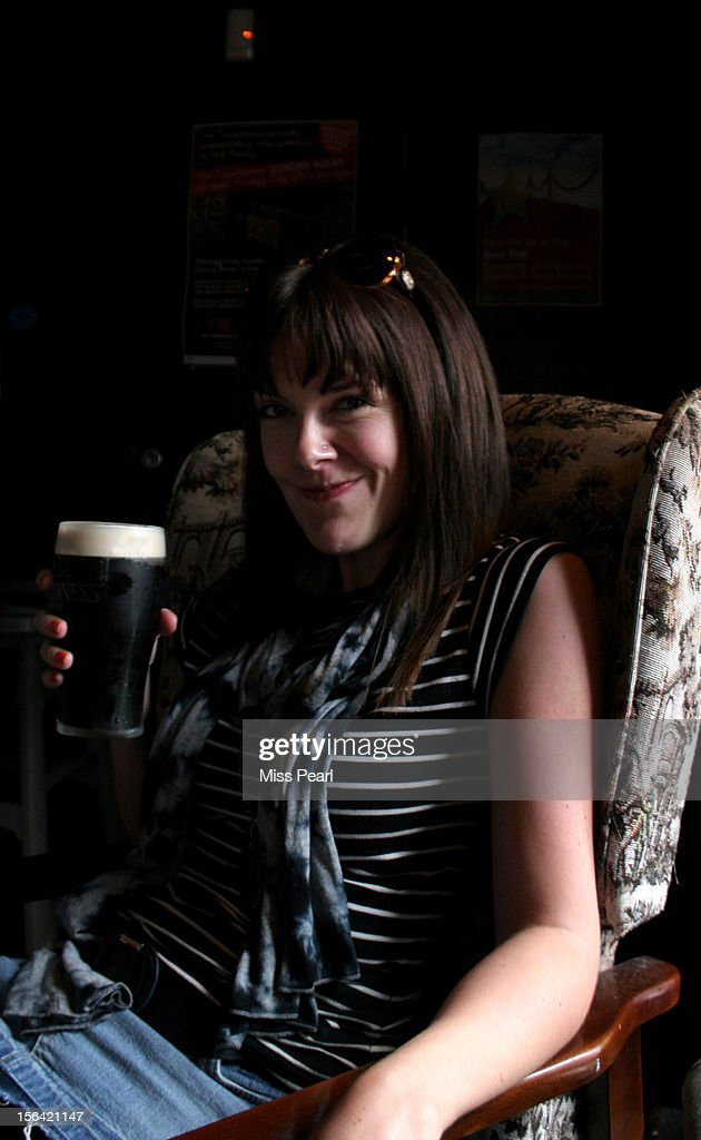 Woman enjoys pint of Irish stout : Stock Photo
