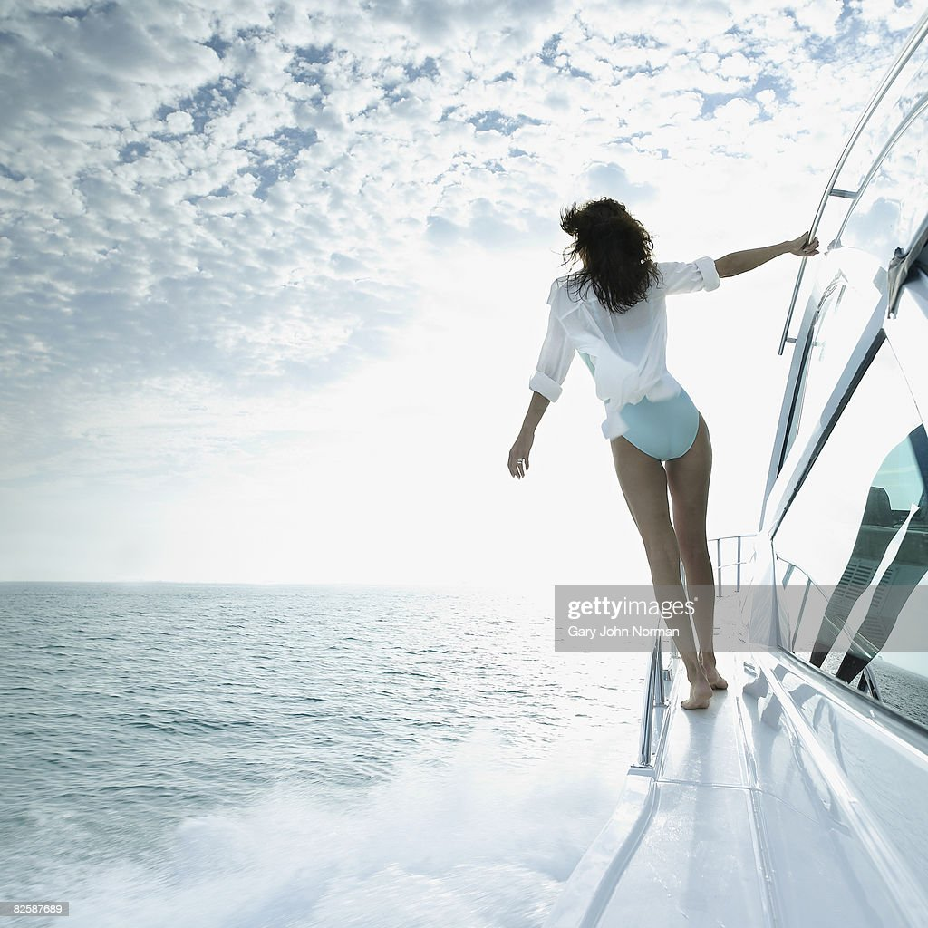 Woman enjoys the breeze and speed of power boat