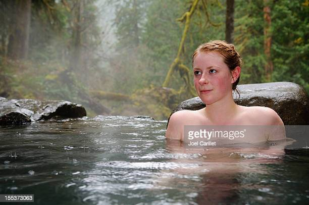 Woman at natural hot springs in the forest