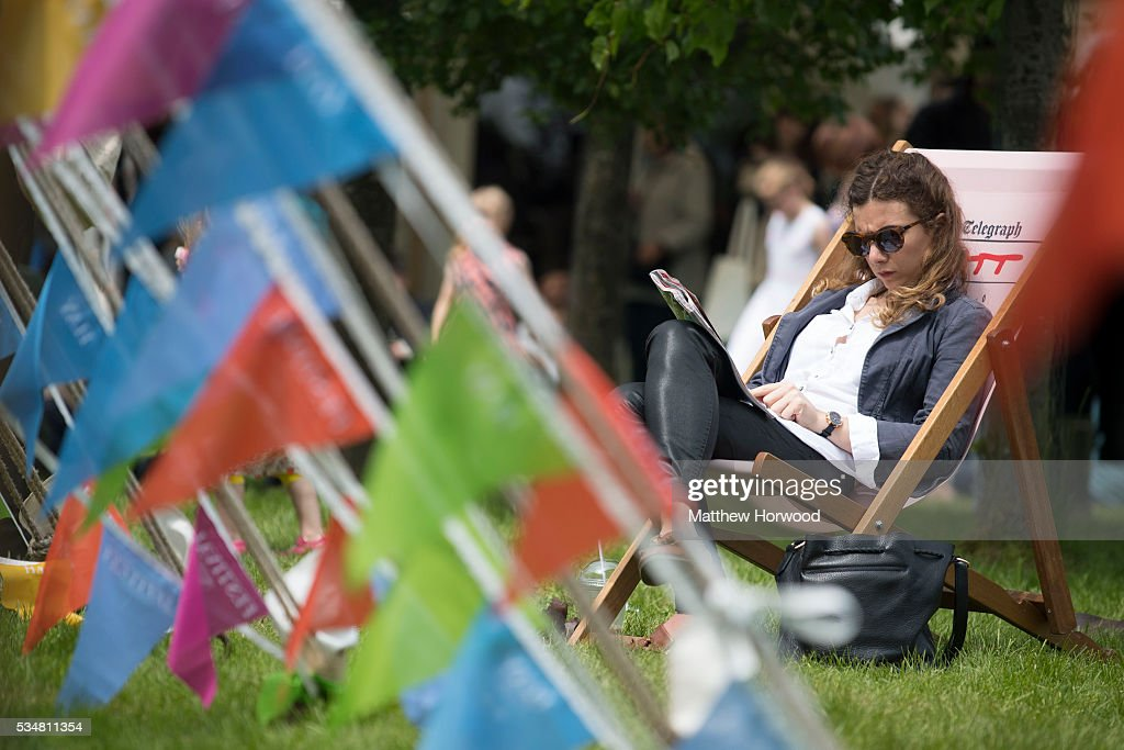 A woman enjoys the sun during the warm summer weather in Hay-on-Wye during the 2016 Hay Festival on May 28, 2016 in Hay-on-Wye, Wales. The Hay Festival is an annual festival of literature and arts now in its 29th year.